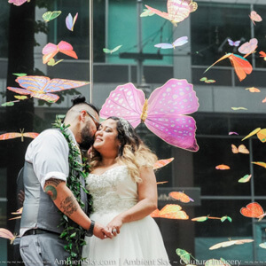 Portland wedding photography bride and groom in front of butterfly mural