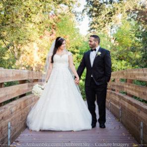 Portland wedding photography bride and groom walking on wooden bridge.