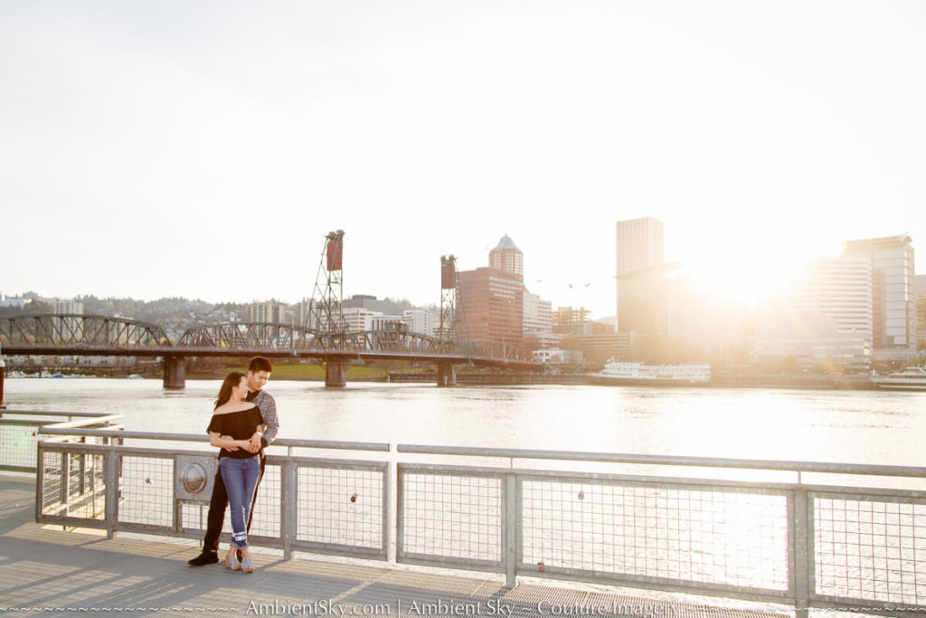 Portland city skyline Engagement photography couple at sunset along the willamette river